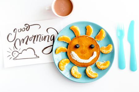 Foto de concept kid breakfast with pancake top view on white background - Imagen libre de derechos