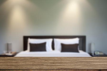 Photo pour Wood desk decoration with bedroom background - image libre de droit