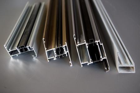 Foto de protruded aluminum profile for windows and doors manufacturing .selective focus - Imagen libre de derechos