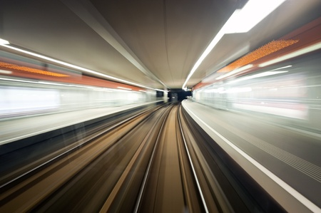 Subway train, driving at speed past a station
