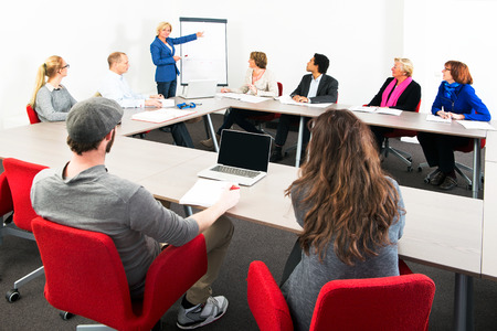 Photo for Several businesspeople meeting in a spaceous meeting room for a presentation - Royalty Free Image