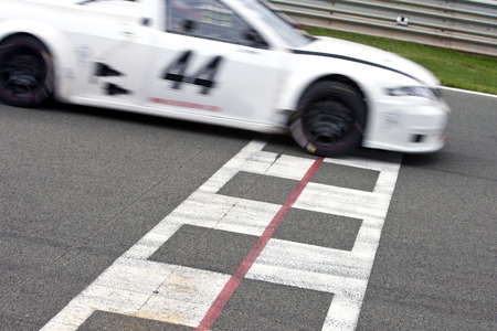 Photo for Race car crossing the finish line on a circuit - Royalty Free Image