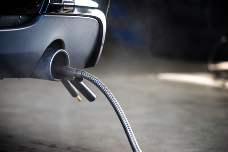 Photo pour A probe, with a diagnostic sensor, measuring the composition and substances in the exhaust fumes of an automotive diesel engine - image libre de droit