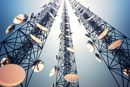 Photo pour Three tall telecommunication towers with antennas on blue sky. View from the bottom. - image libre de droit