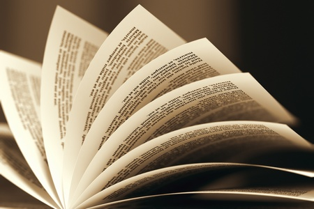 Photo pour Image of a book with turning pages in sepia color scheme  Might be useful for education, litarature, wisdom illustrating purposes  - image libre de droit