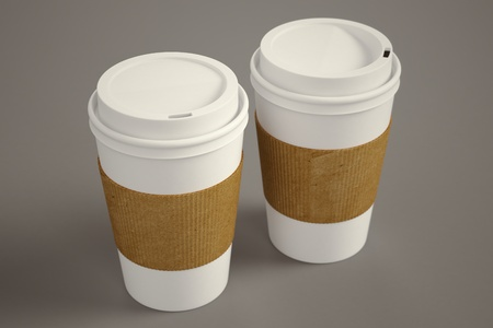 Photo for White paper take-away coffee cups with brown holding stripe on a brown background  Suitable for cafeterias, representing breakfast, morning and freshly made coffee  - Royalty Free Image
