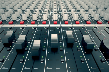 Photo for Closeup on a sliders of a mixing console. It is used for audio signals modifications to achieve the desired output. Applied in recording studios, broadcasting, television and film post-production. - Royalty Free Image