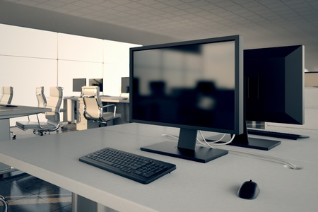 Photo pour Closeup on a white office desk with a monitor and keybord on top  Illustrates arrangement and furnishing of a modern office interior, comfortable business space and professionalism  - image libre de droit