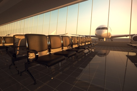 Modern airport terminal with black leather seats at sunset. A huge viewing glass facade with a passenger aircraft behind it.