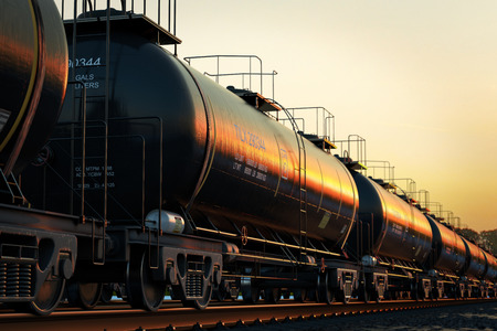 Photo pour Transportation tank cars with oil during sunset. - image libre de droit