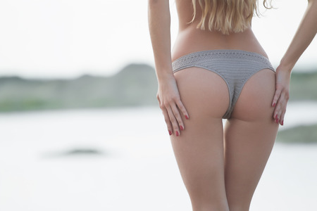 Photo pour Closeup of a sexy woman's ass wearing in panties isolated on white background. - image libre de droit