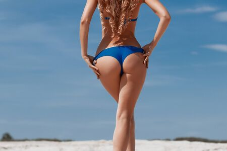 Photo for Girl with perfect figure in swimsuit on the beach - Royalty Free Image