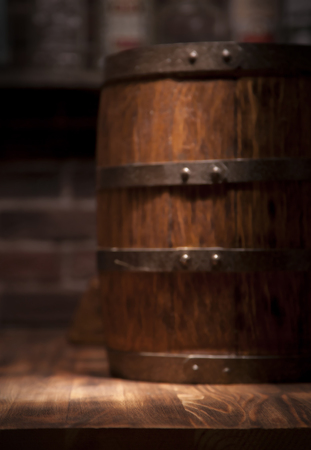 Photo pour Barrel of whiskey on rustic table.blur bar background. - image libre de droit