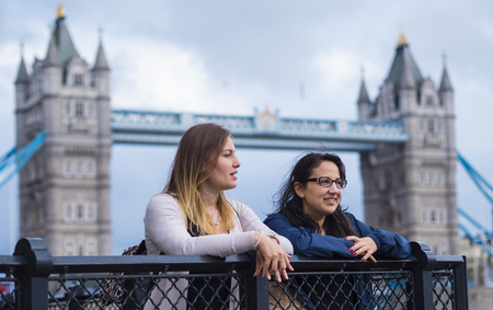 Photo for The Tower Bridge London with two girls on a sightseeing tour - Royalty Free Image