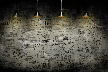 Foto de business strategy on the wall with lamp - Imagen libre de derechos