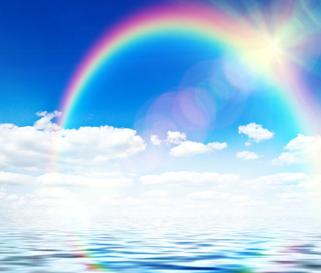 Photo pour Blue sky background with rainbow and reflection in water - image libre de droit