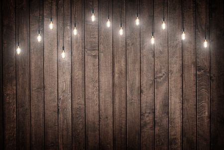 Photo for Light bulbs on dark Wooden Background - Royalty Free Image