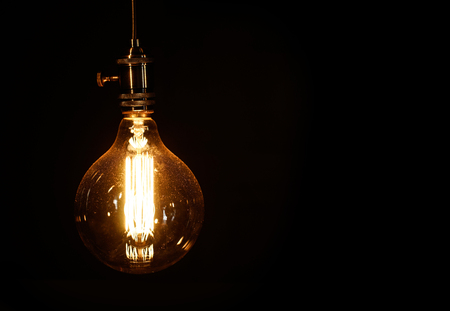 Foto de Edison light bulb on black background - Imagen libre de derechos