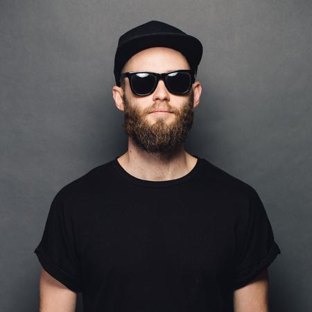 Foto de Hipster handsome male model with beard wearing black blank t-shirt - Imagen libre de derechos