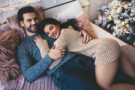 Photo pour Passionate romantic couple spending time before New Year near beautiful Christmas tree at home - image libre de droit