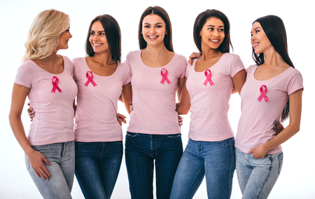 Photo pour Group of young multiracial woman with pink ribbons are struggling against breast cancer. Breast cancer awareness concept. - image libre de droit