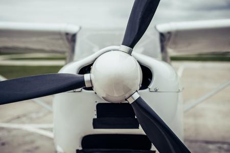 Foto de Light propeller airplane on runway. Small private fix-wing plane. Close-up of propeller. - Imagen libre de derechos