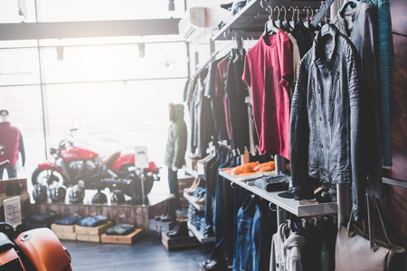 Photo for Motorcycles and accessories in modern motorcycle shop. Biker stuff and clothes. - Royalty Free Image