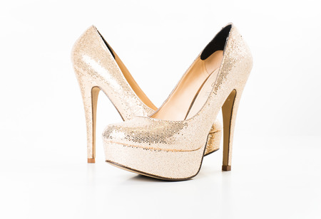 Photo for fashion gold female high heeled shoes on white isolated - Royalty Free Image