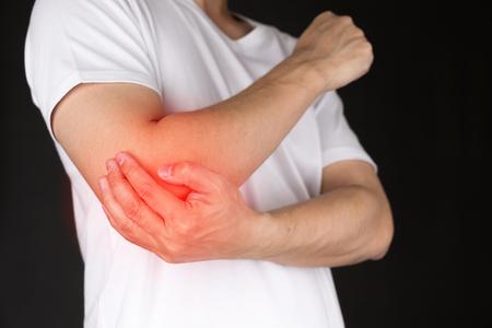 Photo pour Man with elbow pain - image libre de droit