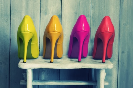 Photo pour Retro photo of pink, yellow and red shoes - image libre de droit