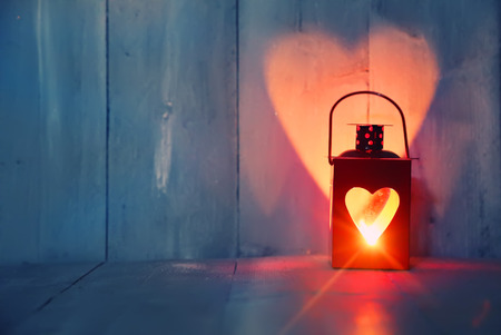 Foto de St Valentine's day greeting card with candle and hearts - Imagen libre de derechos