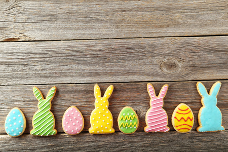 Colorful easter cookies on grey wooden background