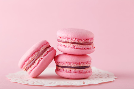 Photo pour French pink macarons on pink background - image libre de droit