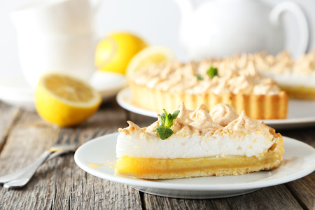Photo for Lemon meringue pie on plate on grey wooden background - Royalty Free Image