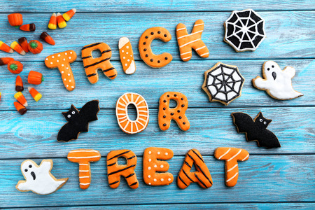 Photo for Fresh halloween gingerbread cookies on blue wooden table - Royalty Free Image