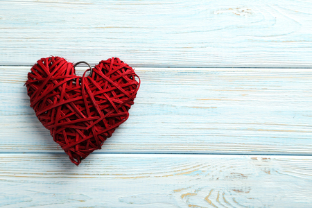 Foto de Love heart on a blue wooden background - Imagen libre de derechos