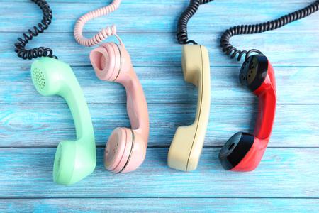 Photo pour Telephone handsets on blue wooden table - image libre de droit