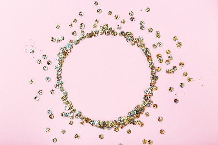 Photo for Round colorful sequins on pink background - Royalty Free Image