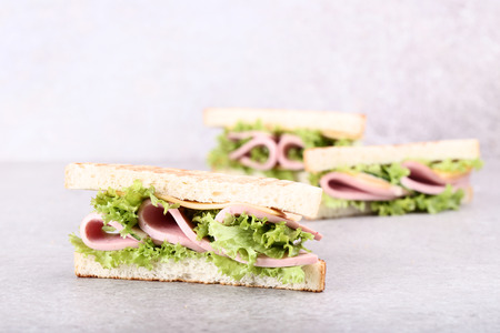 Photo for Sandwiches with ham, cheese and vegetables on grey background - Royalty Free Image