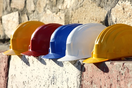 Photo pour helmets close up on work place  - image libre de droit