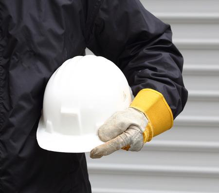 Foto de A Man holding white helmet close up - Imagen libre de derechos