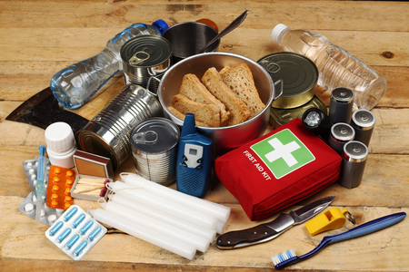 Foto de Items of emergency on wooden table - Imagen libre de derechos