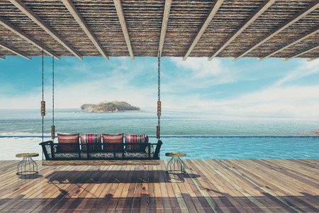 Photo for Beautiful swing sofa furnish and pillow for decoration and relax at balcony and pool sea view ,Vintage Tone - 3d rendering - Royalty Free Image