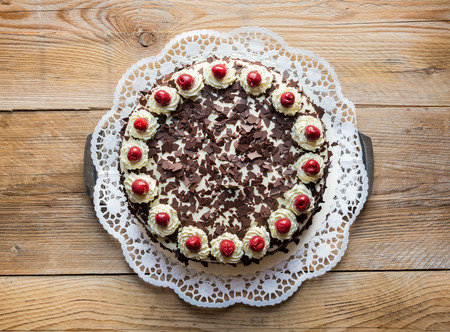 Photo for Black Forest cake on rustic wood. - Royalty Free Image