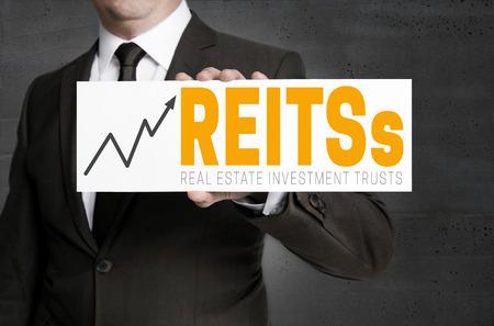 Foto de REITs sign is held by businessman concept. - Imagen libre de derechos