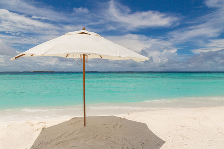 Foto de Beach umbrella on the beach Atoll island Maldives. - Imagen libre de derechos