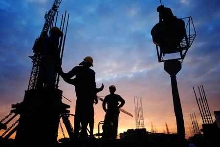Photo pour  silhouette of construction worker on construction site - image libre de droit