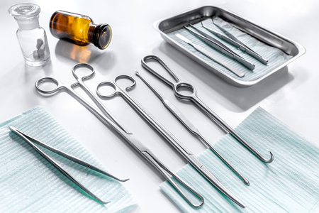 Photo for Rejuvenation by plastic surgery: medical instruments on white table backgrond - Royalty Free Image