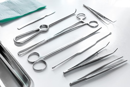Foto de Medical instruments for plastic surgery on white backgrond top view copyspace. - Imagen libre de derechos