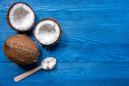 Photo for fresh coconut food and wooden spoon on blue table background top view mockup - Royalty Free Image